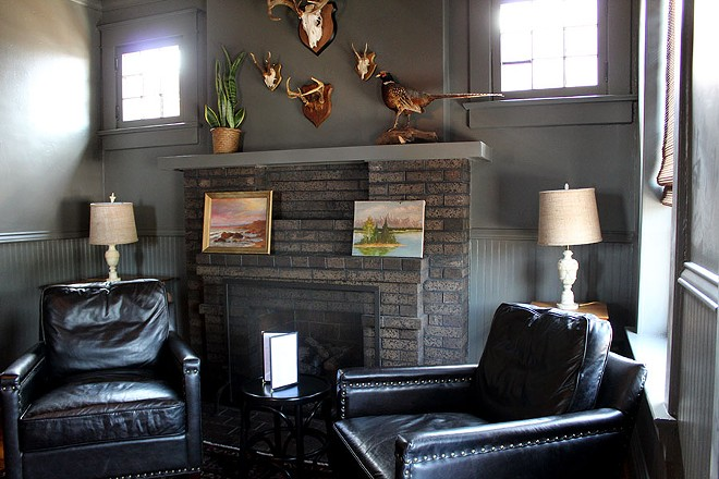 An upstairs lounge area that is decorated to look like someone's home. - LEXIE MILLER