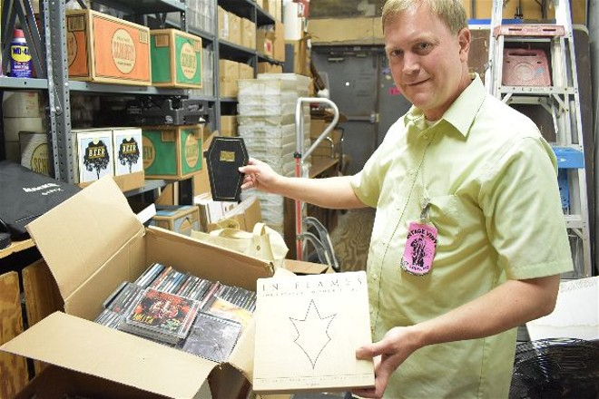 Matt Harnish shows off some of the massive haul in the back room of Vintage Vinyl. - DANIEL HILL