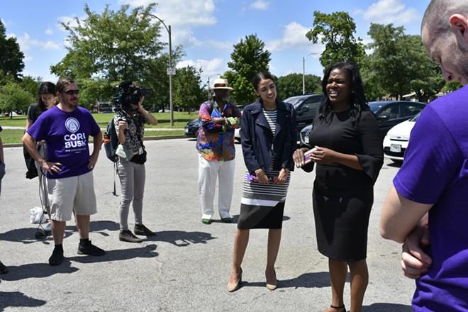 Cori Bush speaks to her enthusiastic volunteers. - PHOTO BY JAIME LEES