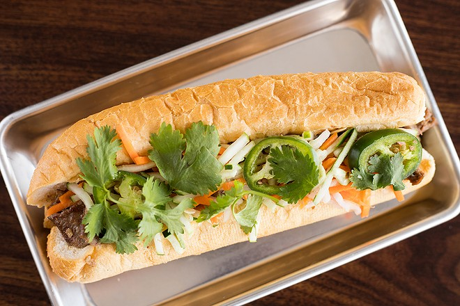 Bánh mì  is topped with a pickled medley and house mayo, but no pât&eacute. - MABEL SUEN