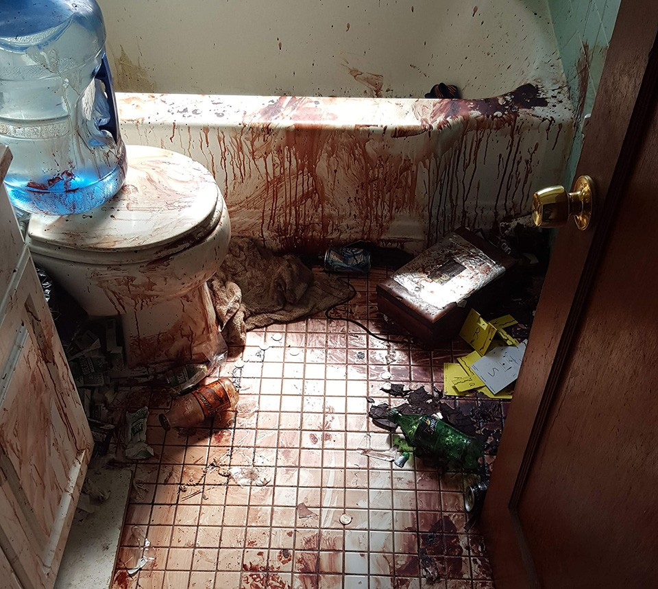 The blood-smeared bathroom in Herter's apartment was a horror movie come to life.