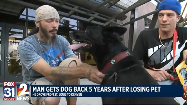 Molly the dog with her two owners. She's returning to St. Louis today with Jason Senseney, right. - SCREENSHOT VIA FOX31