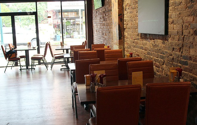 There are several different dining spaces, a game room on the second floor and a beer garden out back. - LEXIE MILLER