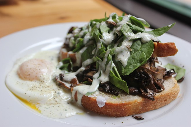 "The ""Artisan Toast"" is topped with avocado, mushrooms and spinach, with an egg on the side. - SARAH FENSKE"