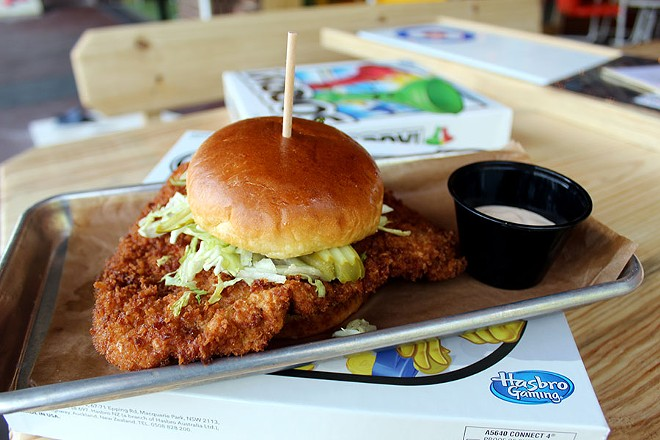 The pork tenderloin sandwich is topped with lettuce, pickle and chipotle mayo. - LEXIE MILLER