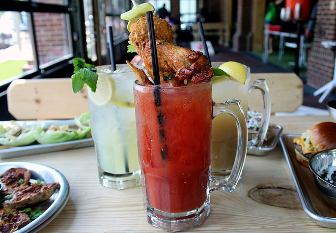 """The """"Ridiculous Bloody Mary"""" topped with a chicken wing, fried mushroom and pickle. - LEXIE MILLER"""