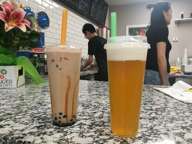 Classic milk tea with boba (left) and mango green tea with cheese. - IAIN SHAW