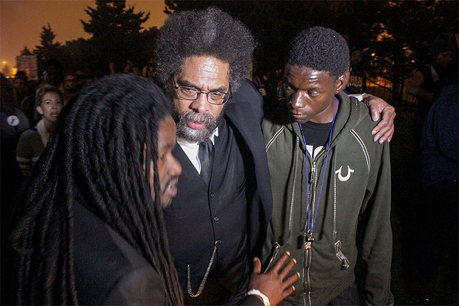 Josh Williams, right, with Cornel West during a protest in St. Louis in 2014. - DANNY WICENTOWSKI
