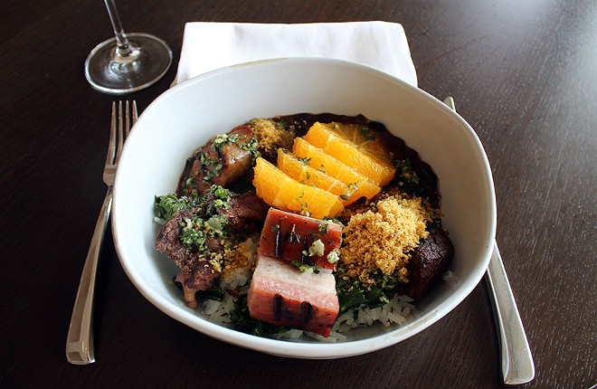 The feijoada is served with five different meats including calabrese sausage, braised beef, pork belly, pork cheek and ham hock. - LEXIE MILLER