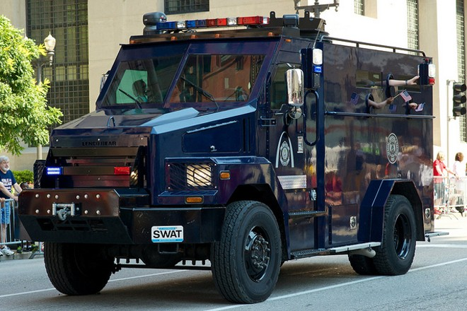The St. Louis SWAT team shows off its fancy toys at a 2013 parade. - FLICKR/CHRIS KOERNER