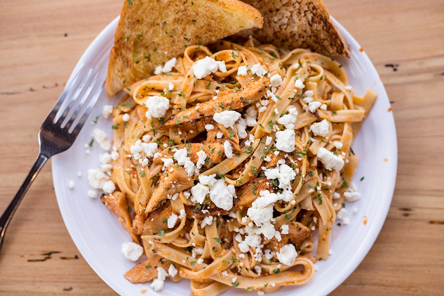 The chicken pasta is topped with tomato sauce, feta and Italian herbs. - MABEL SUEN