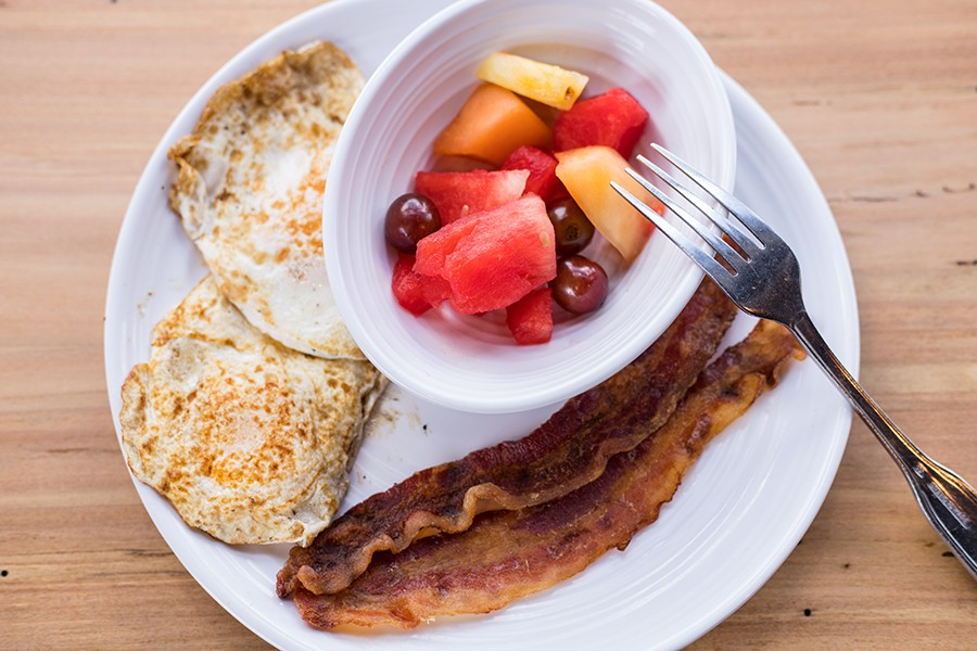 The waffle platter comes with two eggs, bacon and fresh fruit. - MABEL SUEN