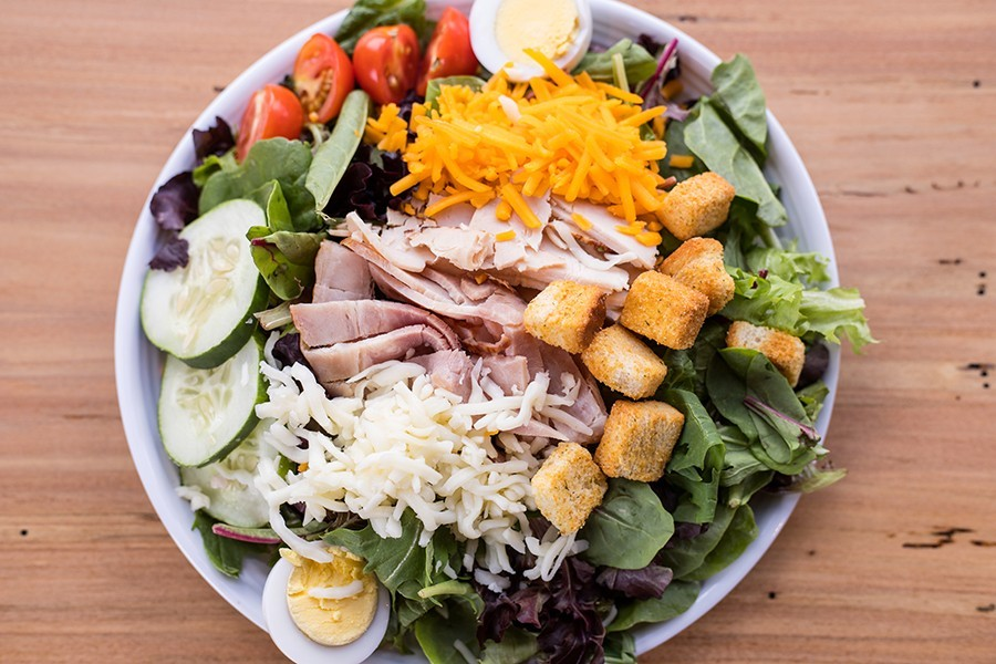 24:1's chef salad is laden with turkey, ham, tomato, cucumber and cheddar and Swiss cheese.