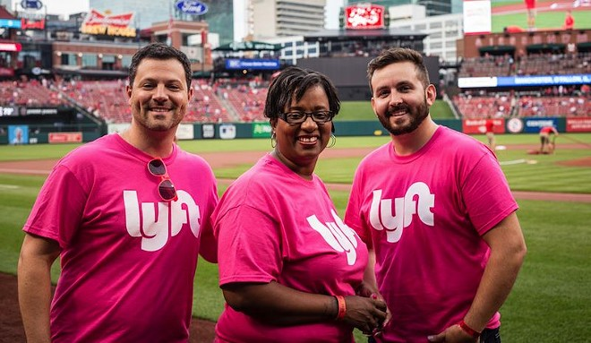 Lyft driver Michele Thompson, center, with Market Manager Joe Schlichter (left) and Marketing Associate Jeff Potzman. Thompson, a cancer survivor, threw out the first pitch at the Cardinals game on July 31. - COURTESY OF LYFT