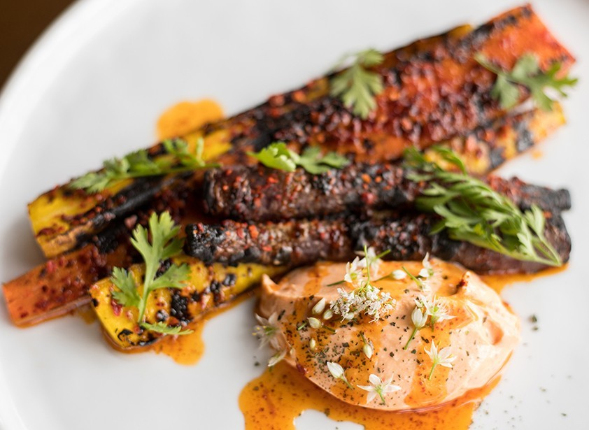 The Benevolent King's grilled carrots involve Aleppo pepper, yogurt, elderflower vinegar and chile oil.
