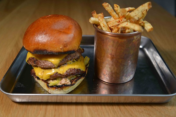 This double cheeseburger is made from dry aged beef. - TOM HELLAUER