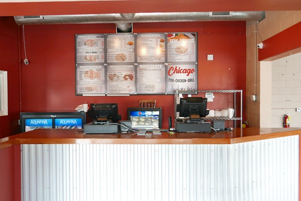 The large menu sits behind the front counter with plenty of options. - DESI ISAACSON