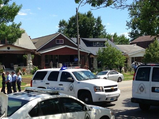 St. Louis Police work a crime scene in south city. - DOYLE MURPHY
