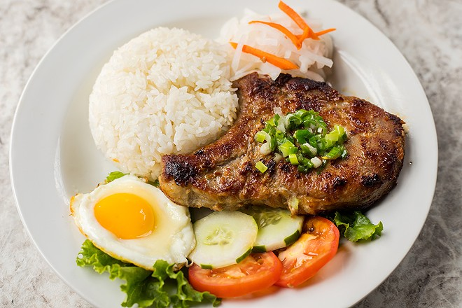 VP Square's char-grilled lemongrass pork chop is served with steamed rice and lime fish sauce. - MABEL SUEN