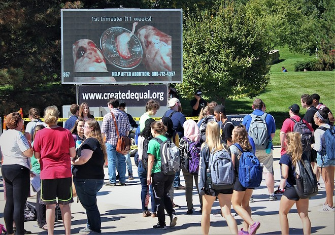 Students at the University of Toledo are confronted by photos graphically depicting abortion. - COURTESY OF CREATED EQUAL