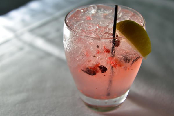 """50/Fifty event coordinator Tim Chalcraft has been working with veteran mixologist Jolene Gosha to create cocktails, such as the """"Ginberry Smash."""" - TOM HELLAUER"""