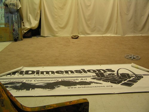 Where the stage will eventually be located, in the center of the right side of the room