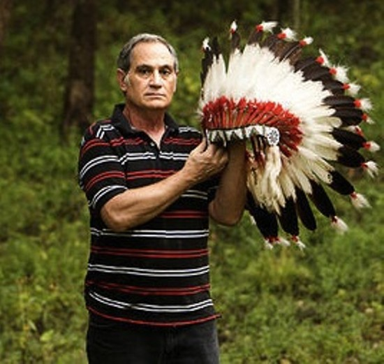 Kevin Airis with an eagle-feather headdress the St. Louis Science Center returned to him in 2007. - JENNIFER SILVERBERG FOR RFT