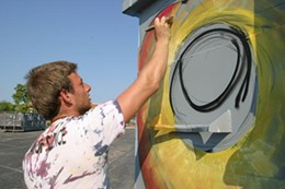 Jacob Schmidt, 18, is beautifying city trash bins for free - PHOTO BY NICHOLAS PHILLIPS