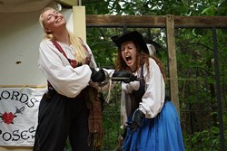 "Maria Romine, playing the pirate Angelique LeFleur, ""stabs"" St. Louis actress Beth Ashby during a Swords and Roses show. - PHOTOS COURTESY OF MARIA ROMINE"