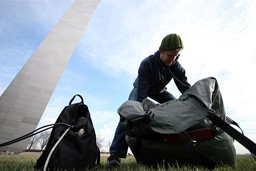 Kuehnle puts down his gear underneath the Gateway Arch. See a slideshow of Kuehnle's journey in St. Louis. - PHOTO: NICK SCHNELLE