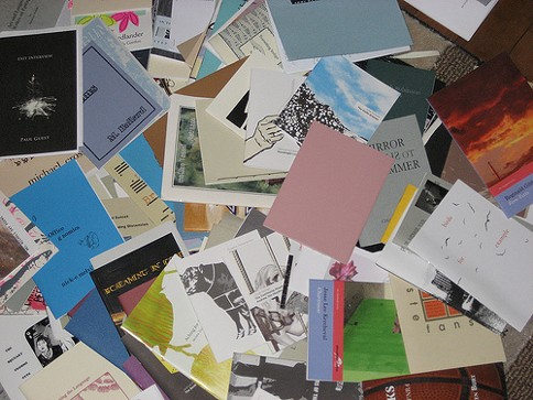 An assortment of chapbooks. - FLICKR.COM/PHOTOS/CAPABLEMOTION
