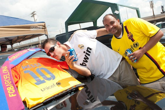Fans display (and kiss) a Messi jersey. - JON GITCHOFF