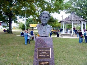 The Mansfield, Missouri, town square, with a bust of its most famous resident.