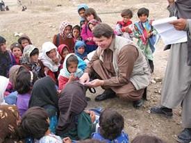 Mortenson meets children in rural Pakistan. - IMAGE VIA
