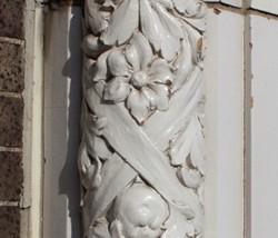 Terra-cotta detail on Cinderella Building. - PHOTO BY CHRIS NAFFZIGER