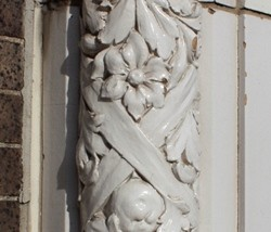 Terra-cotta detail on Cinderella Building. - PHOTO BY CHRIS NAFFZIGER