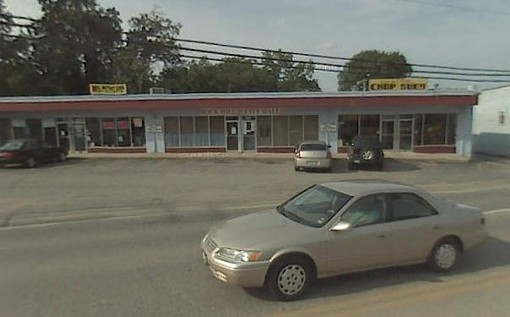 Rock Hill City Hall sits sandwiched between a payday loan store and a Chinese take-out on Manchester Road. - GOOGLE STREET VIEW