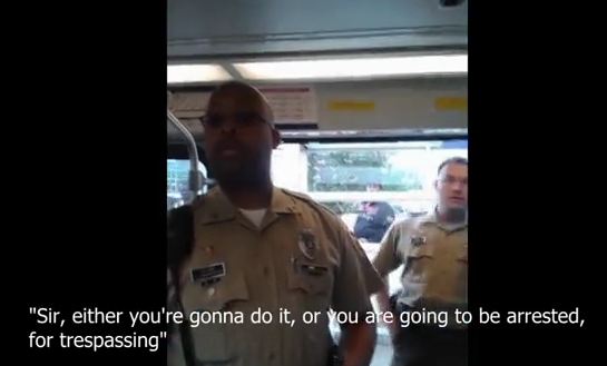 In Suitter's YouTube video, police ask him to exit the train. - YOUTUBE