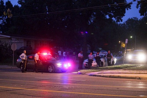 Police stood guard at entrances to many residential streets on Monday evening.