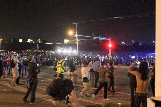 The tense situation at the corner of West Florissant and Ferguson avenues.
