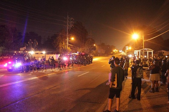 A  crowd congregated near the entrance of Northwinds Estates Drive around 9:30 p.m.