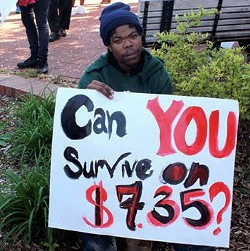 A St. Louis worker protests the minimum wage. - KRYSTYNA NINH FOR RFT