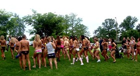 Braving angry skies, these bikini-clad gals (and guys) wanted to break a world record. They did not. - THE TAN COMPANY