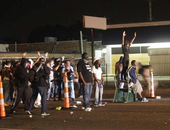 Protesters dragged traffic cones, bricks, shopping carts and other items to fashion a makeshift blockade on West Florissant Avenue. - DANNY WICENTOWSKI