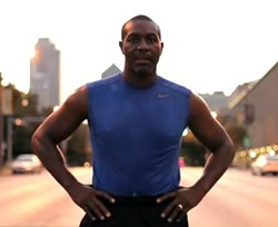 Aldermanic President Lewis Reed steps to the line. - LEWIS REED VIA YOUTUBE