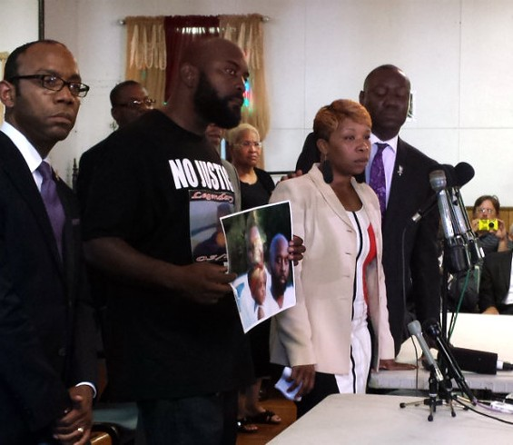 NAACP President Cornell Brooks, Michael Brown Sr. (Michael Brown's father), Lesley McSpadden (Michael Brown's mother) and attorney Benjamin Crump. - JESSICA LUSSENHOP