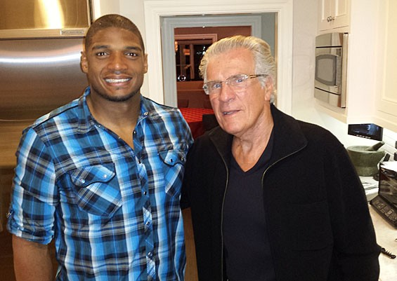 Michael Sam and David Kopay at sports publicist Howard Bragman's home. - COURTESY JIM BUZINSKI