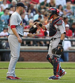 Yadier Molina gives the ball to Chris Carpenter. - KEITH ALLISON ON FLICKR