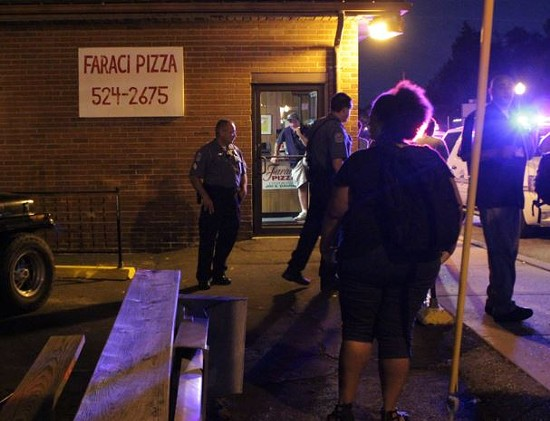 Protesters claim the owner of Faraci Pizza pointed a gun at them Thursday night, but the restaurant owner's wife says that's a lie. - DANNY WICENTOWSKI