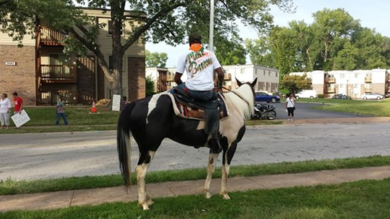 Django rides Shiloh while wearing a Michael Brown shirt. - JESSICA LUSSENHOP